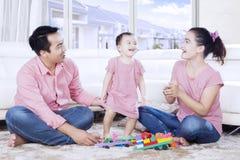 Asian parents and daughter playing together Stock Photos