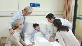 Asian parents and grandparents visiting hospitalized child