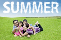 Asian parents lay at field with their children Royalty Free Stock Image