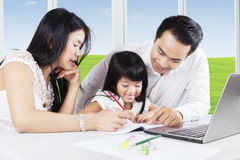 Asian parents teach their daughter to study Royalty Free Stock Photo