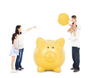 Asian parents teaching daughters financial concept. With a piggy bank Royalty Free Stock Photo