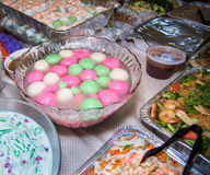 Asian party foods with shrimp and sticky rice colorful. Asian fiesta party foods with shrimp and rice flours cake Royalty Free Stock Photo