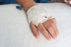Asian patient boy hand with saline intravenous (iv) on hospital Royalty Free Stock Photos