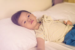Asian patient boy on hospital bed Stock Images