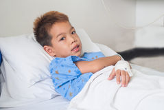 Asian patient boy with saline intravenous (iv). Royalty Free Stock Photos