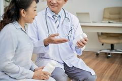 Asian Patient Talking to Doctor royalty free stock images