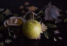Asian Pear on Antique Floral Sideboard stock images