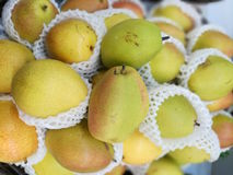 Asian pears. These asian pears give off greens and reds for sale in a market stock images
