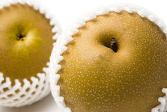 Asian pears in shipping net Royalty Free Stock Images