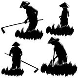 Asian peasants work on a field Royalty Free Stock Photo
