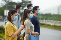Asian pedestrians in protective masks Stock Images