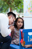 Asian pediatrician during medical appointment Stock Image