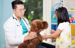 Asian pediatrician with teddy bear Royalty Free Stock Photo