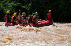 Asian people in action at rafting adventure Royalty Free Stock Photos