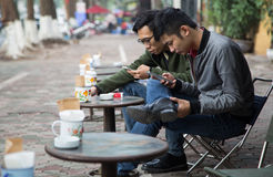 Asian people drinking coffee on the sidewalk stock images