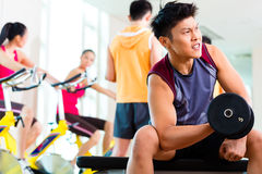Asian people exercising sport for fitness in gym Royalty Free Stock Images