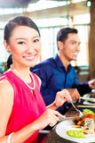 Asian people fine dining in restaurant Royalty Free Stock Image