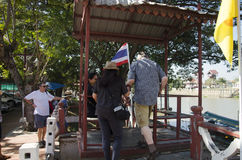 Asian people and foreign traveler use cable car across chao phraya river Stock Photo