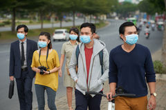 Asian people in medical masks Stock Image