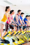 Asian people in spinning bike training at fitness gym Royalty Free Stock Photography
