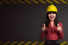 Asian people wearing yellow helmet Royalty Free Stock Photo