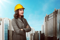 Asian people wearing yellow helmet Royalty Free Stock Images