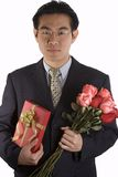 Asian People With Roses And Present Royalty Free Stock Photos