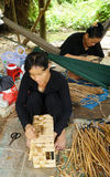 Asian people work inside coir mat workshop Stock Photos