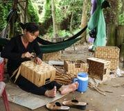 Asian people work inside coir mat workshop Royalty Free Stock Image