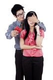 Asian person giving surprise to girlfriend Royalty Free Stock Image