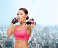 Asian personal trainer with whistle Royalty Free Stock Images