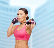 Asian personal trainer with whistle Stock Images