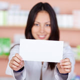 Asian pharmacist displaying white paper Stock Photo