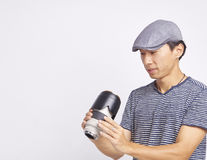 Asian photographer checking lens isolated on white Stock Image