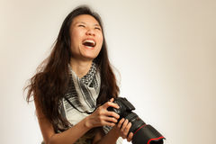 Asian photographer laugthing Royalty Free Stock Image