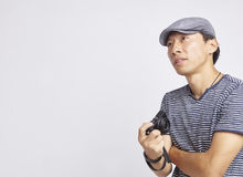 Asian photographer looking into distance isolated on white Stock Image