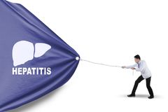Asian physician pulling a banner with hepatitis word Royalty Free Stock Photo