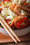 Asian Pig ears salad with fresh vegetables in a bowl macro. vert Stock Image