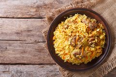 Asian pilaf on a brown plate. horizontal top view, rustic Royalty Free Stock Photography