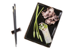Asian plate. Pretty asian black plate with small muskoctopus and a vietnamese springroll Stock Photo