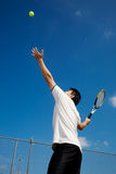 Asian playing tennis Royalty Free Stock Photo