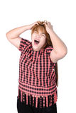 Asian plump woman holding her head frowning with worry. pulling Royalty Free Stock Photography