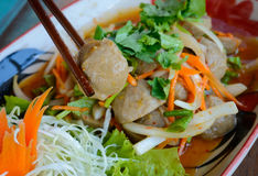 Asian pork balls. Traditional Asian pork balls with salad and chopsticks Stock Image