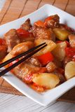 Asian pork meat with pineapple on a plate close-up. Vertical Royalty Free Stock Photo