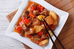 Asian pork with pineapple on a plate close-up. top view horizont Royalty Free Stock Images