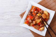 Asian pork with pineapple in sweet and sour sauce. top view Stock Photo