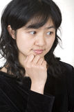 Asian portrait 2. Thinking royalty free stock photography
