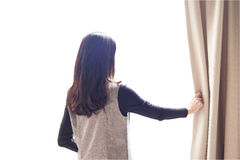 Asian portrait beautiful woman opening curtains on white backgro Stock Photo