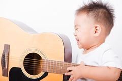 Asian portrait child boys 1 year 6 months playing guitar royalty free stock photography
