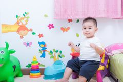 Asian portrait cute child boy and there are toys on back royalty free stock photo